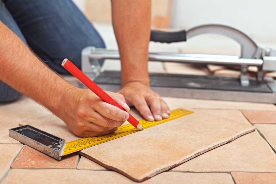 Man is measuring tile slab